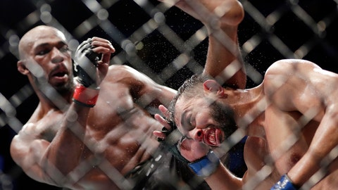 <p>               Jon Jones, left, delivers a kick to Dominick Reyes, right, during a light heavyweight mixed martial arts bout at UFC 247 Sunday, Feb. 9, 2020, in Houston. (AP Photo/Michael Wyke)             </p>