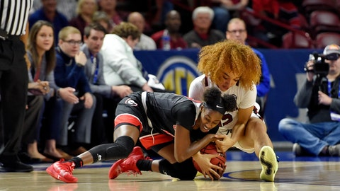 <p>               Georgia's Maya Caldwell, left, and South Carolina's Brea Beal battle for a loose ball during a quarterfinal match at the Southeastern women's NCAA college basketball tournament in Greenville, S.C., Friday, March 6, 2020. (AP Photo/Richard Shiro)             </p>