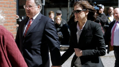 <p>               FILE - In this April 3, 2019, file photo, Manuel and Elizabeth Henriquez arrive at federal court in Boston to face charges in a nationwide college admissions bribery scandal. Henriquez and her husband were charged with paying $400,000 in bribes to get their oldest daughter into Georgetown as a bogus tennis recruit in 2016. They also paid bribes to have someone cheat on their daughters' college entrance exams, authorities said. (AP Photo/Steven Senne, File)             </p>