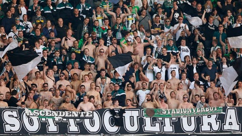 "<p>               FILE-In this April 30, 2016 file photo Moenchengladbach supporter cheer their team during the German Bundesliga soccer match between FC Bayern Munich and Borussia Moenchengladbach at the Allianz Arena stadium in Munich, Germany. The league has been suspended through April 30 at least due to the coronavirus outbreak and it's likely that fans will be excluded if it resumes. Public life in Germany has been largely shut down to contain the virus, and clubs are resigned to more so-called ""ghost games"" without supporters if the season is to be concluded. (AP Photo/Matthias Schrader)             </p>"