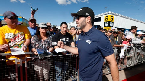 <p>               Driver Jimmie Johnson acknowledges fans as he walks to the drivers' meeting prior to a NASCAR Cup Series auto race at Phoenix Raceway, Sunday, March 8, 2020, in Avondale, Ariz. (AP Photo/Ralph Freso)             </p>
