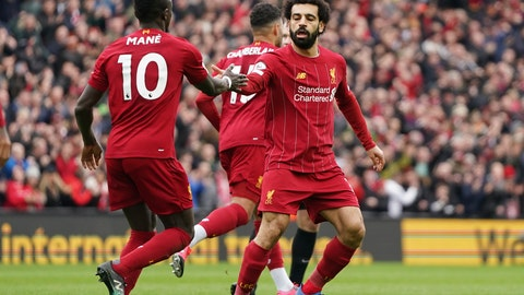 <p>               Liverpool's Mohamed Salah, right, celebrates with his teammate Sadio Mane after scoring his side's opening goal during the English Premier League soccer match between Liverpool and Bournemouth at Anfield stadium in Liverpool, England, Saturday, March 7, 2020. (AP Photo/Jon Super)             </p>