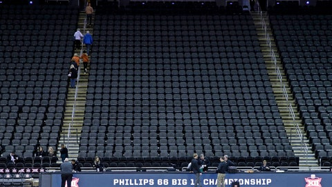 <p>               Fans leave the Sprint Center after the remaining NCAA college basketball games after in the Big 12 Conference tournament were canceled due to concerns about the coronavirus Thursday, March 12, 2020, in Kansas City, Mo. (AP Photo/Charlie Riedel)             </p>