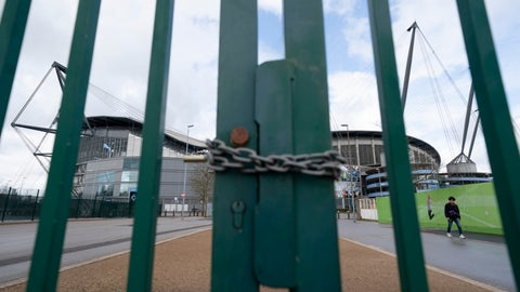 <p>               A locked gate is seen by the Etihad Stadium where Manchester City was due to play Burnley in an English Premier League soccer match Saturday March 14, 2020, after all English soccer games were cancelled due to the spread of the COVID-19 Coronavirus. For most people, the new COVID-19 coronavirus causes only mild or moderate symptoms, but for some it can cause more severe illness.(AP Photo/Jon Super)             </p>