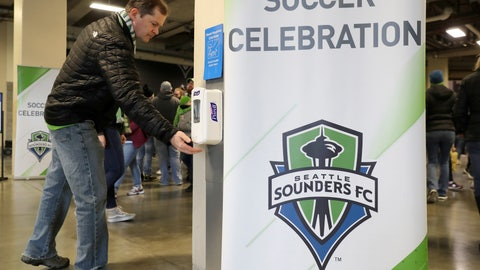 <p>               A man makes use of a hand-sanitizing station at CenturyLink Field prior to an MLS soccer match between the Seattle Sounders and the Chicago Fire, Sunday, March 1, 2020, in Seattle. Major North American professional sports leagues are talking to health officials and informing teams about the coronavirus outbreak. (AP Photo/Ted S. Warren)             </p>