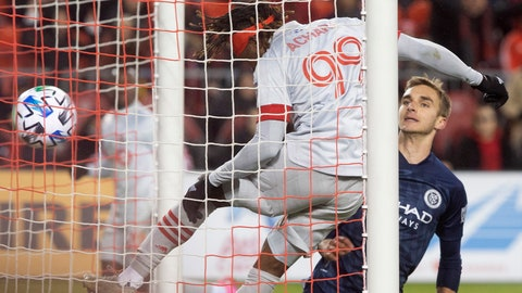 <p>               Toronto FC forward Ifunanyachi Achara (99) heads his team's game winning goal as New York City FC midfielder James Sands (16) looks on during the second half of an MLS soccer game in Toronto, Saturday March 7, 2020. (Chris Young/The Canadian Press via AP)             </p>