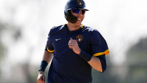 <p>               FILE - In this Feb. 19, 2020, file photo, Milwaukee Brewers' Christian Yelich reacts during a spring training baseball workout  in Phoenix. The Brewers are reportedly working on a new contract with star slugger Christian Yelich. It's an encouraging sign for Milwaukee after it lost a couple key performers during free agency. (AP Photo/Gregory Bull, File)             </p>