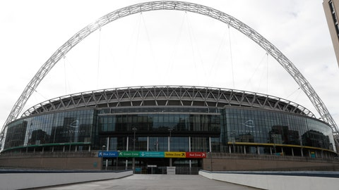 <p>               A general view of Wembley Stadium in London, Tuesday, March 17, 2020. UEFA has formally proposed postponing the 2020 European Championship for one year because of the coronavirus outbreak. The Norwegian soccer association says the new tournament dates will be June 11 to July 11. (AP Photo/Alastair Grant)             </p>