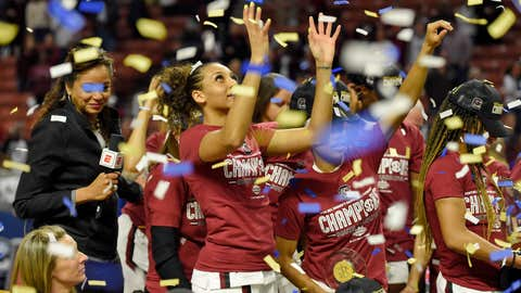 <p>               South Carolina's Mikiah Herbert-Harrigan grabs for confetti after defeating Mississippi State in a championship match at the Southeastern Conference women's NCAA college basketball tournament in Greenville, S.C., Sunday, March 8, 2020. (AP Photo/Richard Shiro)             </p>