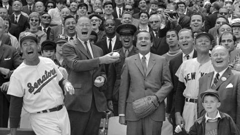 <p>               FILE - In this April 7, 1969, file photo, President Richard Nixon and Baseball Commissioner Bowie Kuhn, center-left, join Washington Senators manager Ted Williams, left, in a round of laughter before the chief executive tossed out the first ball in an opening day baseball game at RFK Stadium in Washington. (AP Photo/File)             </p>