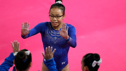 <p>               FILE - In this July 27, 2019, file photo, Morgan Hurd is congratulated by teammates after competing in the women's gymnastics qualification and team final at the Pan American Games in Lima, Peru. Hurd has arguably spent the last three years as the best gymnast in the world not named Simone Biles. The 2017 world champion, however has work to do to assure herself of an Olympic spot. The journey begins in earnest on Saturday at the American Cup.  (AP Photo/Rebecca Blackwell, File)             </p>