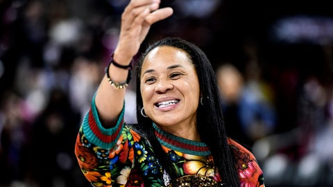 <p>               FILE- In this Dec. 15, 2019, file photo, South Carolina head coach Dawn Staley participates in the school anthem after an NCAA college basketball game against Purdue in Columbia, S.C. The veteran Gamecocks coach was announced as The Associated Press women's basketball coach of the year Monday, March 23, 2020. (AP Photo/Sean Rayford, File)             </p>