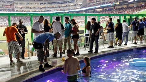 <p>               FILE - In this April 2, 2012 file photo fans watch from the swimming pool at Marlins Park during a spring training baseball game between the Miami Marlins and the New York Yankees in Miami. The Clevelander nightclub at Marlins Park has closed. It included a swimming pool, dancers and DJs, and had been a staple at the ballpark since it opened in 2012. The space will still be accessible to fans with different seating and without the pool, but the bar remains. Marlins Park has undergone a gradual makeover since Derek Jeter's group bought the team in late 2017. Before the 2019 season, Jeter removed the kitschy home run sculpture from the outfield. (AP Photo/Wilfredo Lee, file)             </p>