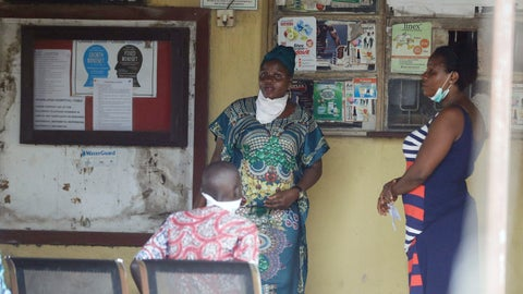 <p>               Women wearing face masks wait for drugs at the Yaba Mainland hospital where an Italian citizen - the country's first case of the COVID-19 virus - is being treated, in Lagos, Nigeria Friday, Feb. 28, 2020. Nigeria's health authorities have reported the country's first case of a new coronavirus in Lagos, the first confirmed appearance of the disease in sub-Saharan Africa. (AP Photo/ Sunday Alamba)             </p>