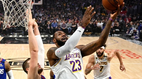 <p>               Los Angeles Lakers forward LeBron James, right, shoots as Los Angeles center Ivica Zubac defends during the first half of an NBA basketball game Sunday, March 8, 2020, in Los Angeles. (AP Photo/Mark J. Terrill)             </p>