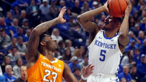 <p>               Kentucky's Immanuel Quickley (5) shoots while defended by Tennessee's Jordan Bowden (23) during the first half of an NCAA college basketball game, Tuesday, March 3, 2020, in Lexington, Ky. (AP Photo/James Crisp)             </p>