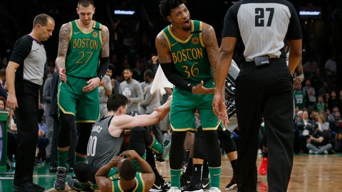 <p>               Boston Celtics guard Marcus Smart (36) complains about a jump-ball call to referee Mitchell Ervin (27) during the second half of the team's NBA basketball game against the Brooklyn Nets, Tuesday, March 3, 2020, in Boston. (AP Photo/Mary Schwalm)             </p>