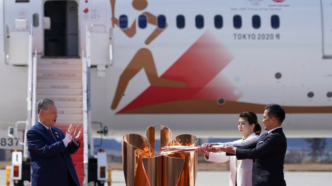 <p>               Three-time Olympic gold medalists Tadahiro Nomura, right, and Saori Yoshida light the torch as Tokyo 2020 Olympics chief Yoshiro Mori, left, watches during Olympic Flame Arrival Ceremony at Japan Air Self-Defense Force Matsushima Base in Higashimatsushima in Miyagi Prefecture, north of Tokyo Friday, March 20, 2020. The Olympic flame from Greece arrived in Japan even as the opening of the the Tokyo Games in four months is in doubt with more voices suggesting the games should to be postponed or canceled because of the worldwide virus pandemic. (AP Photo/Eugene Hoshiko)             </p>