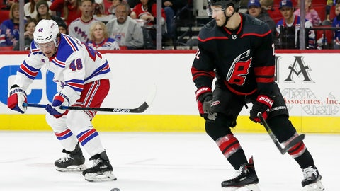 <p>               New York Rangers left wing Brendan Lemieux (48) passes the puck while Carolina Hurricanes defenseman Brett Pesce, right, defends during the first period of an NHL hockey game in Raleigh, N.C., Friday, Feb. 21, 2020. (AP Photo/Gerry Broome)             </p>