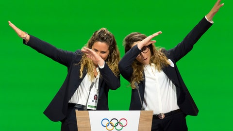 <p>               FILE - In this Monday, June 24, 2019 filer, Italian snowboarder Michela Moioli, left, and Italian skier Sofia Goggia, right, dab after speaking during the presentation of the Milan-Cortina candidate cities the first day of the 134th Session of the International Olympic Committee (IOC), in Lausanne, Switzerland. Eight months later Goggia and Moioli feel like their worlds are crumbling apart as they are locked inside their homes just a few miles apart in the Bergamo area of northern Italy that is struggling to keep up with the coronavirus, they are surrounded by death and despair. For most people, the new coronavirus causes only mild or moderate symptoms. For some it can cause more severe illness. (Laurent Gillieron/Keystone via AP, File)             </p>
