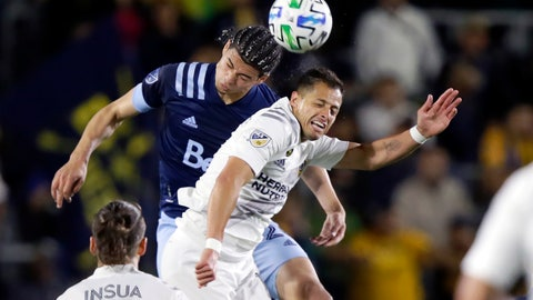 <p>               Vancouver Whitecaps defender Jasser Khmiri, left, battles LA Galaxy forward Javier Hernandez, right, for a header during the first half of an MLS soccer match in Carson, Calif., Saturday, March 7, 2020. (AP Photo/Alex Gallardo)             </p>