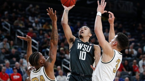 <p>               Washington State's Isaac Bonton (10) shoots over Colorado's Eli Parquet (24) and Maddox Daniels (3) during the first half of an NCAA college basketball game in the first round of the Pac-12 men's tournament Wednesday, March 11, 2020, in Las Vegas. (AP Photo/John Locher)             </p>