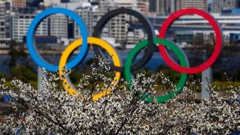 <p>               The Olympic rings are seen behind cherry blossoms Wednesday, March 25, 2020, in the Odaiba section of Tokyo. Not even the Summer Olympics could withstand the force of the coronavirus. After weeks of hedging, the IOC took the unprecedented step of postponing the world's biggest sporting event, a global extravaganza that's been cemented into the calendar for more than a century. (AP Photo/Jae C. Hong)             </p>