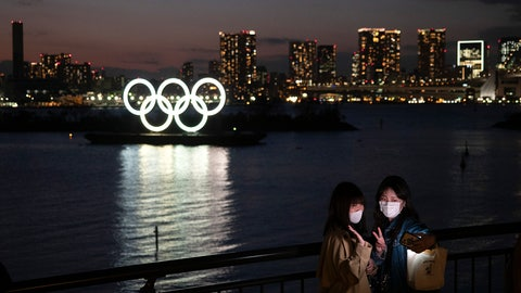"""<p>               Two women take a selfie with the Olympic rings in the background in the Odaiba section of Tokyo, Thursday, March 12, 2020. Tokyo Governor Yuriko Koike spoke Thursday after the World Health Organization labeled the spreading virus a """"pandemic,"""" a decision almost certain to affect the Tokyo Olympics. (AP Photo/Jae C. Hong)             </p>"""