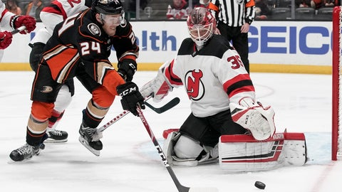 <p>               New Jersey Devils goaltender Cory Schneider, right, blocks a shot by Anaheim Ducks center Carter Rowney during the second period of an NHL hockey game in Anaheim, Calif., Sunday, March 1, 2020. (AP Photo/Chris Carlson)             </p>