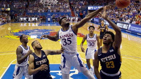 <p>               FILE - In this Nov. 19, 2019, file photo, Kansas center Udoka Azubuike (35) blocks a shot by East Tennessee State forward Vonnie Patterson (23) during the second half of an NCAA college basketball game in Lawrence, Kan. Azubuike was selected to the Associated Press All-Big 12 first team announced Tuesday, March 10, 2020. Azubuike was also named the AP Big 12 Player of the Year. (AP Photo/Charlie Riedel, File)             </p>