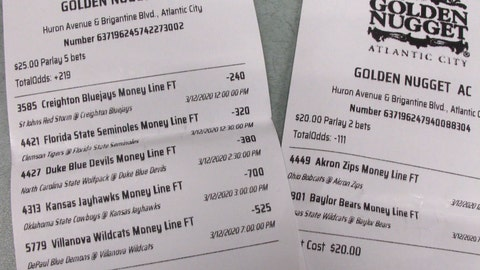 <p>               This March 12, 2020 shows a sports betting ticket at the Golden Nugget casino in Atlantic City, N.J. where all five games that were bet on were canceled due to coronavirus precautions. Most professional and college sports events in the U.S. have been suspended or delayed, leaving little to bet on. For most people, the new coronavirus causes only mild or moderate symptoms. For some it can cause more severe illness. (AP Photo/Wayne Parry)             </p>