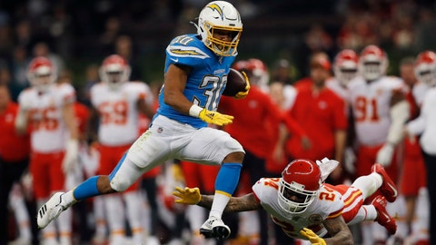 <p>               FILE - In this Nov. 18, 2019, file photo, Los Angeles Chargers running back Austin Ekeler, left, gets past Kansas City Chiefs strong safety Jordan Lucas, right, during the first half of an NFL football game in Mexico City. Ekeler's breakout season with the Los Angeles Chargers has resulted in a contract extension. The running back has agreed to a four-year deal with the Chargers worth #24.5 million, including $15 million guaranteed. Ekeler was slated to be a restricted free agent when the new league year starts on March 18.(AP Photo/Eduardo Verdugo, File)             </p>