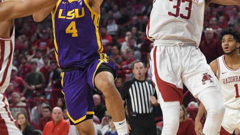<p>               LSU guard Skylar Mays (4) tries to drive past Arkansas defender Jimmy Whitt Jr.  (33) during the second half of an NCAA college basketball game Wednesday, March 4, 2020, in Fayetteville, Ark. (AP Photo/Michael Woods)             </p>