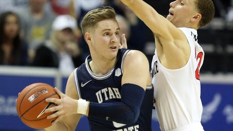 <p>               Utah State's Sam Merrill looks to pass as San Diego State's Malachi Flynn defends during the second half of an NCAA college basketball game for the Mountain West Conference men's tournament championship Saturday, March 7, 2020, in Las Vegas. (AP Photo/Isaac Brekken)             </p>