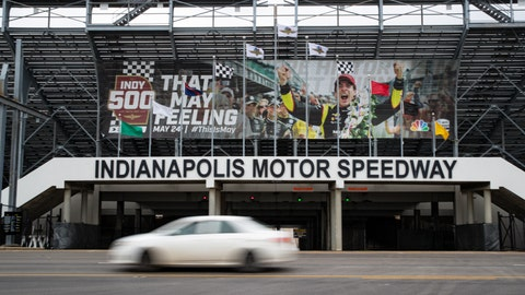 <p>               A car drives past the entrance at the Indianapolis Motor Speedway in Indianapolis, Saturday, March 28, 2020. Roger Penske, at 83 and considered high risk to the coronavirus as a 2017 kidney transplant recipient, still makes the daily three-minute commute to his Bloomfield Hills, Mich, office. He works 12 or more hours a day from his conference room at Penske Corp., which has a skeleton crew all practicing social distancing. Penske also had the small matter of planning his first Indianapolis 500. (AP Photo/Michael Conroy)             </p>