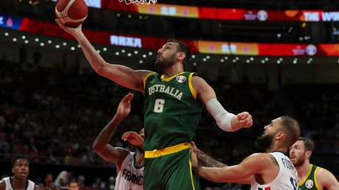 """<p>               FILE - In this Sept. 15, 2019, file photo, Andrew Bogut of Australia puts up a shot over Amath M'Baye, left, and Evan Fournier of France during their third placing match for the FIBA Basketball World Cup at the Cadillac Arena in Beijing. NBA veteran Bogut says players were """"used like pawns"""" in the process that led to his Sydney Kings refusing to fly across the country for Game 4 of the Australian league's finals series because of the coronavirus pandemic, a decision that ultimately handed the championship to Perth. For most people, the new coronavirus causes only mild or moderate symptoms. For some it can cause more severe illness. (AP Photo/Ng Han Guan, File)             </p>"""