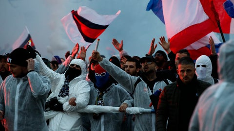 <p>               PSG supporters chant as they gather prior a Champions League round of 16 second leg soccer match between Paris-Saint-Germain and Borussia Dortmund at the Parc des Princes stadium in Paris Wednesday, March 11, 2020. The match is played behind closed doors without spectators due to the COVID-19 outbreak. For most people, the new coronavirus causes only mild or moderate symptoms, such as fever and cough. For some, especially older adults and people with existing health problems, it can cause more severe illness, including pneumonia. (AP Photo/Christophe Ena)             </p>