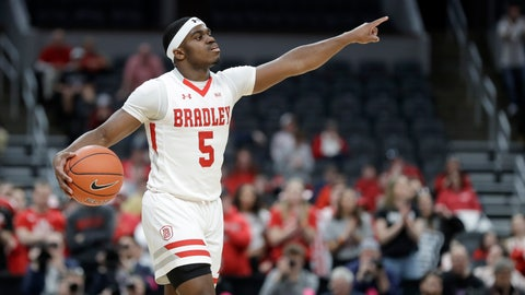 <p>               Bradley's Darrell Brown Jr. points during the first half of an NCAA college basketball game against Valparaiso in the championship of the Missouri Valley Conference men's tournament Sunday, March 8, 2020, in St. Louis. (AP Photo/Jeff Roberson)             </p>