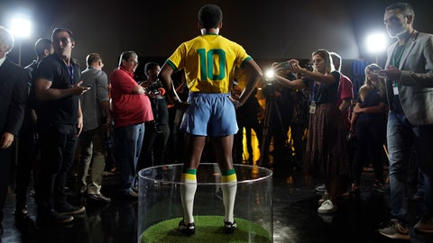 <p>               Journalists stand around the statue of legendary Brazilian player Pele at the Brazilian Soccer Team Museum in Rio de Janeiro, Brazil, Thursday, Feb. 20, 2020. The Brazilian Football Confederation unveiled the statue as part of commemorations of 50 years since the World Cup victory in 1970. (AP Photo/Leo Correa)             </p>