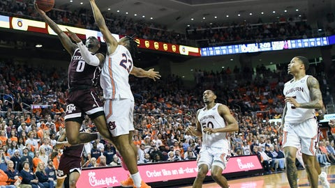 <p>               Texas A&M guard Jay Jay Chandler (0) shoots over Auburn forward Isaac Okoro (23) during the first half of an NCAA college basketball game Wednesday, March 4, 2020, in Auburn, Ala. (AP Photo/Julie Bennett)             </p>