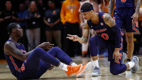 <p>               Auburn guard Samir Doughty (10) and forward Danjel Purifoy (3) react to a 3-point shot during an NCAA college basketball game against Tennessee, Saturday, March 7, 2020, in Knoxville, Tenn. (AP Photo/Wade Payne)             </p>