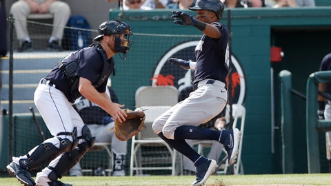<p>               New York Yankees' Rosell Herrera, right, safely beats the throw to Detroit Tigers catcher Jake Rogers to score during a spring training baseball game, Thursday, March 5, 2020, in Lakeland, Fla. (AP Photo/Carlos Osorio)             </p>