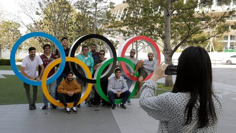 <p>               A group of students from Uruguay pose for a souvenir picture on the Olympic Rings set outside the Olympic Stadium in Tokyo, Saturday, March 21, 2020. The Olympic flame from Greece arrived in Japan Friday, even as the opening of the the Tokyo Games in four months is in doubt with more voices suggesting the games should to be postponed or canceled because of the worldwide virus pandemic. (AP Photo/Gregorio Borgia)             </p>