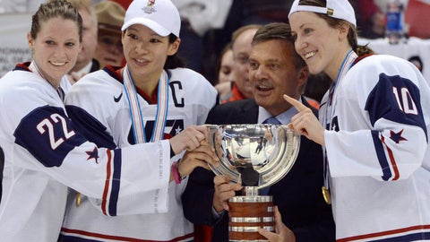 <p>               FILE - In this April 9, 2013, file photo, United States' Kacey Bellamy, Julie Chu and Meghan Duggan, from left, stand with IIHF president Rene Fasel as they are presented with the trophy after the U.S. team defeated Canada 3-2 in the gold medal game at the women's ice hockey world championships in Ottawa, Ontario. The women's world hockey championships in Canada have been canceled because of the new coronavirus. International Ice Hockey Federation President René Fasel tells The Associated Press the decision was made by conference call Saturday, March 7, 2020. (Sean Kilpatrick/The Canadian Press via AP, File)             </p>