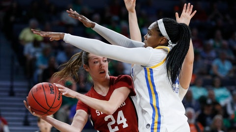 <p>               Stanford's Lacie Hull (24) passes around UCLA's Lauryn Miller, right, during the second half of an NCAA college basketball game in the semifinal round of the Pac-12 women's tournament Saturday, March 7, 2020, in Las Vegas. (AP Photo/John Locher)             </p>