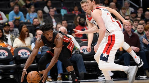 <p>               Miami Heat forward Jimmy Butler, left, grabs the ball next to Washington Wizards guard Garrison Mathews, right, during the first half of an NBA basketball game, Sunday, March 8, 2020, in Washington. (AP Photo/Nick Wass)             </p>