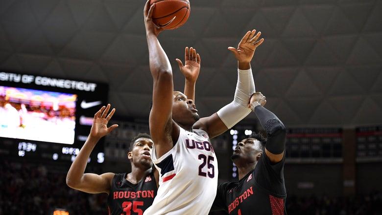 Vital leads UConn to 77-71 win over Houston on senior night