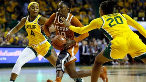 <p>               Texas guard Lashann Higgs (10) drives the lane between Baylor guards Te'a Cooper (4) and Juicy Landrum (20) during the first half of an NCAA college basketball game Thursday, March 5, 2020, in Waco, Texas. (AP Photo/Ray Carlin)             </p>
