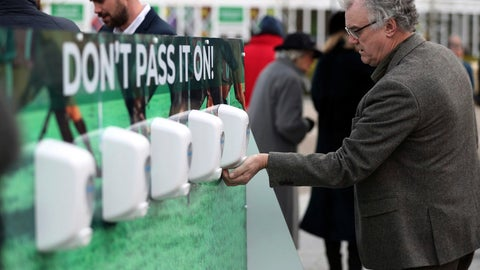 <p>               Racegoers use hand sanitizer to help prevent the spread of coronavirus, on day one of the Cheltenham Festival at Cheltenham Racecourse, Cheltenham, England, Tuesday, March 10, 2020. (Simon Cooper/PA via AP)             </p>