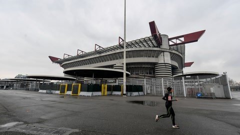 <p>               A woman jogs outside San Siro stadium where a Serie A soccer match between AC Milan and Genoa was supposed to take place but was instead postponed to May 13, 2020, in Milan, Italy, Sunday, March 1, 2020. In Lombardy, the hardest-hit region by the spread of the Coronavirus, schools and universities were ordered to stay closed, and sporting events were canceled.(Claudio Furlan/LaPresse via AP)             </p>